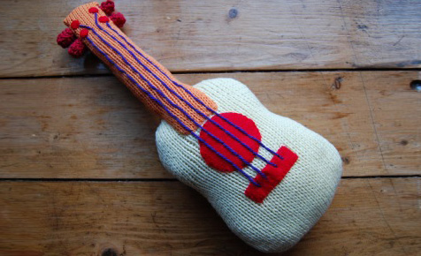 Knitted guitar soft toy