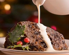 Boiled Christmas pudding with brandy custard