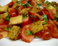 Mixed tomato salad with basil and parmesan croutons