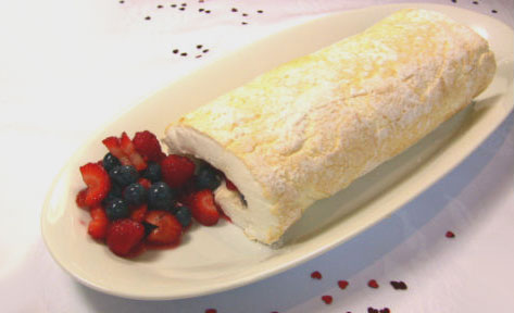 Pavlova roll with rosewater berries