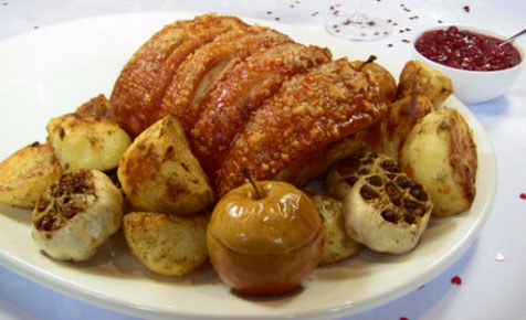 Roast pork with baked apples, potatoes and garlic