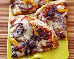 Grilled pizza with sausage, onion and capsicum