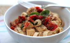Chicken fettucine with basil and tomato cream