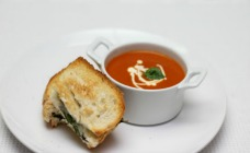 Homemade tomato soup with basil and mozzarella grillers
