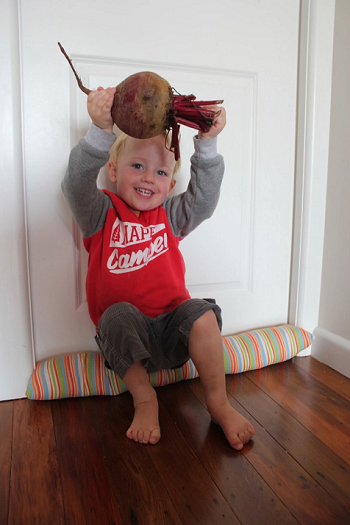 Kid finds beetroot the size of his head at local market.